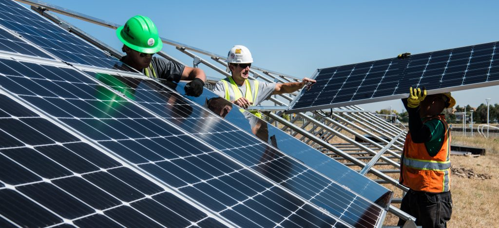men at work with solar panels