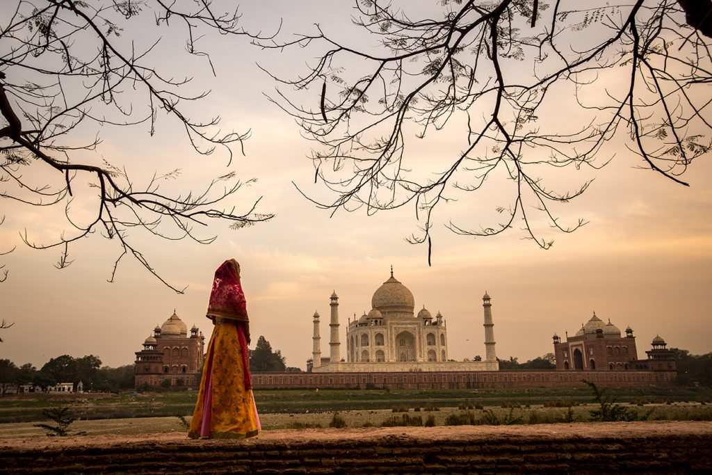 Woman standing outside Taj mahal India