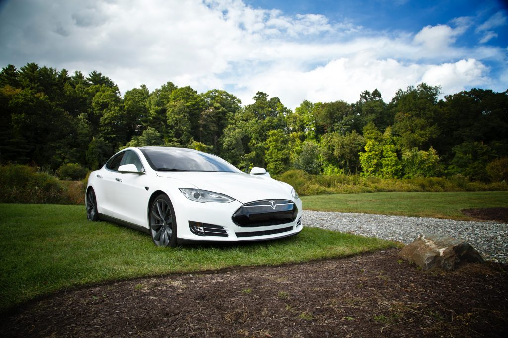 Which standard should be implemented for charging electric vehicle batteries?